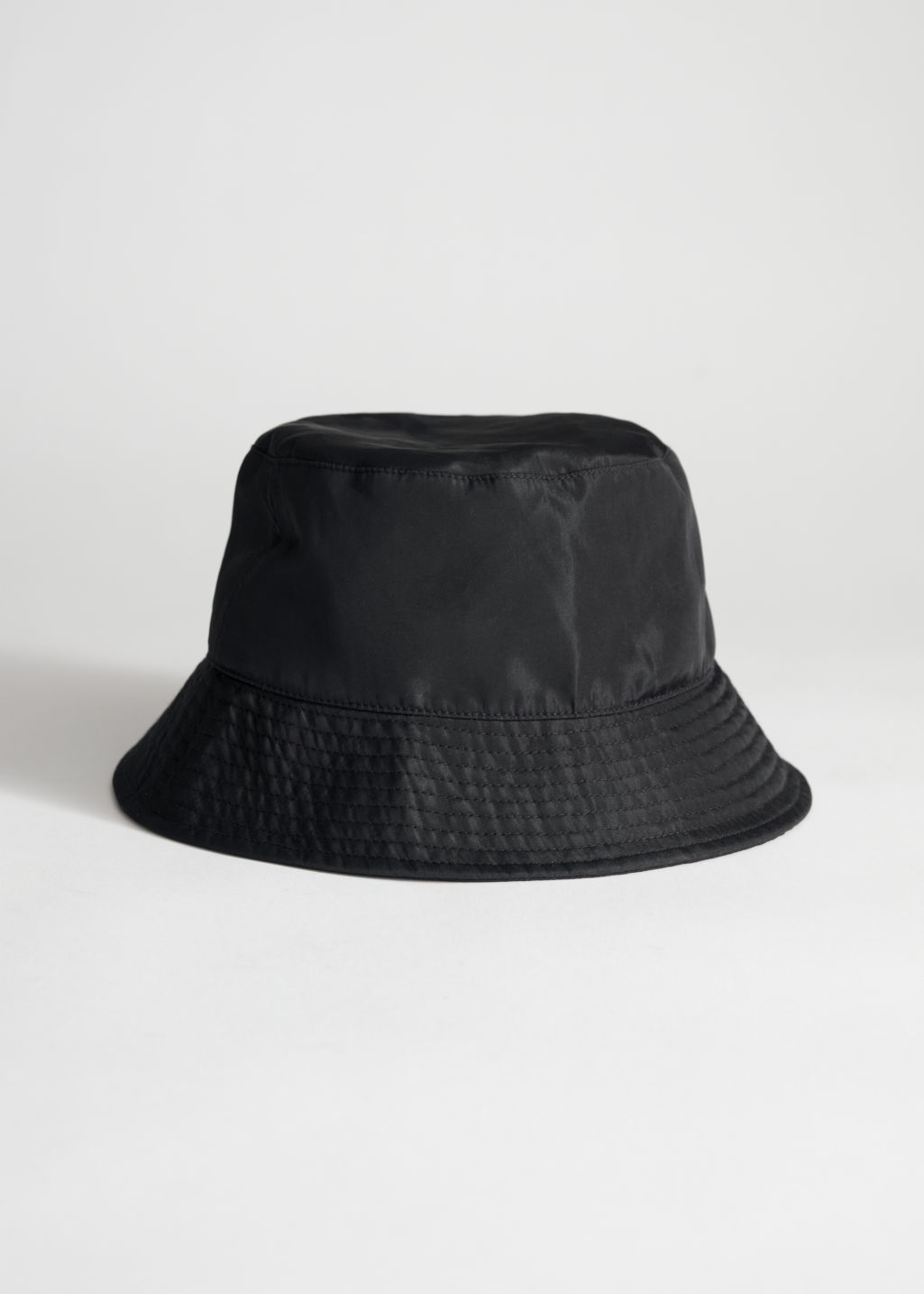 StillLife Front Image of Stories Nylon Bucket Hat in Black