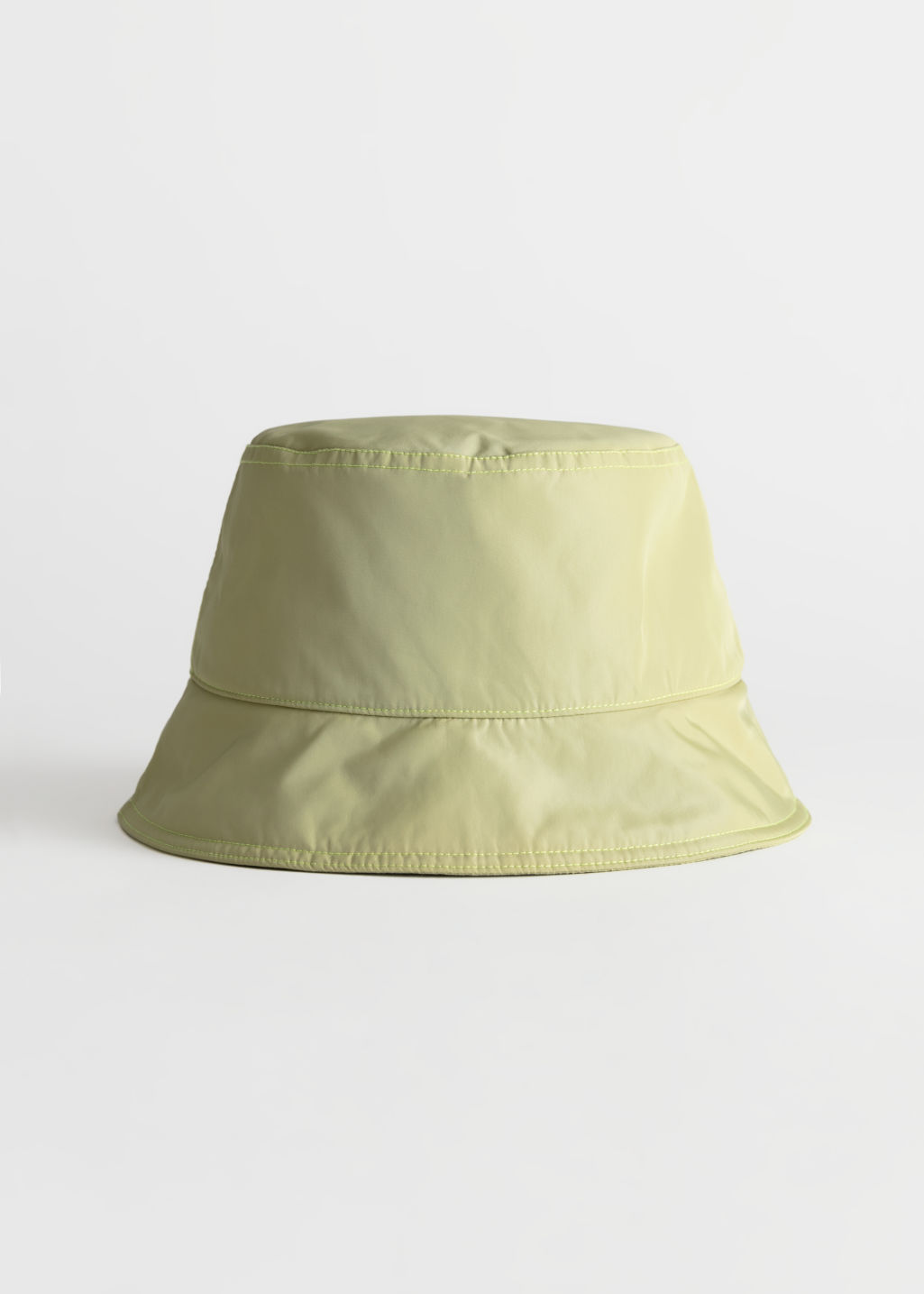 StillLife Front Image of Stories Nylon Bucket Hat in Beige