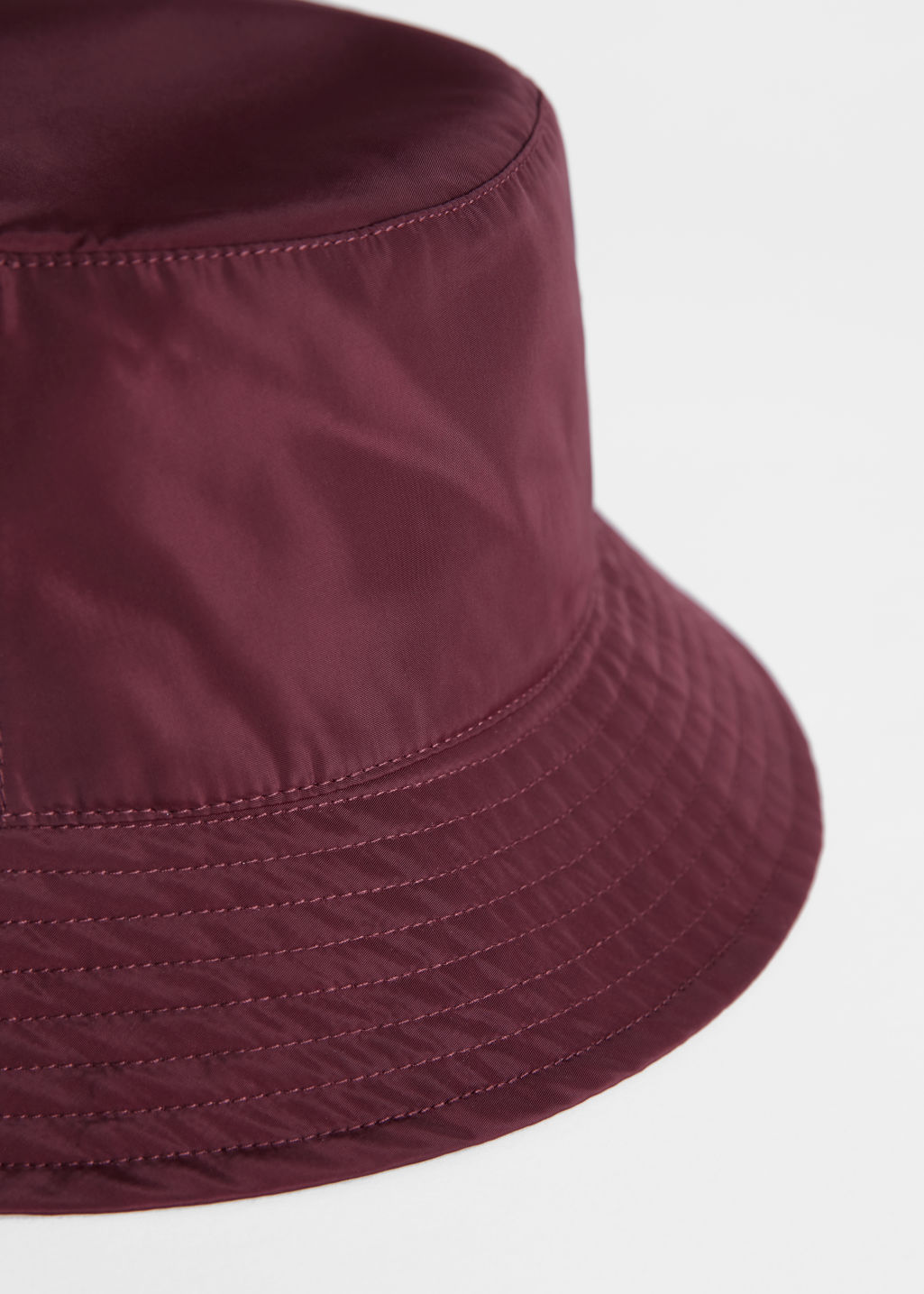 Front image of Stories nylon bucket hat in red