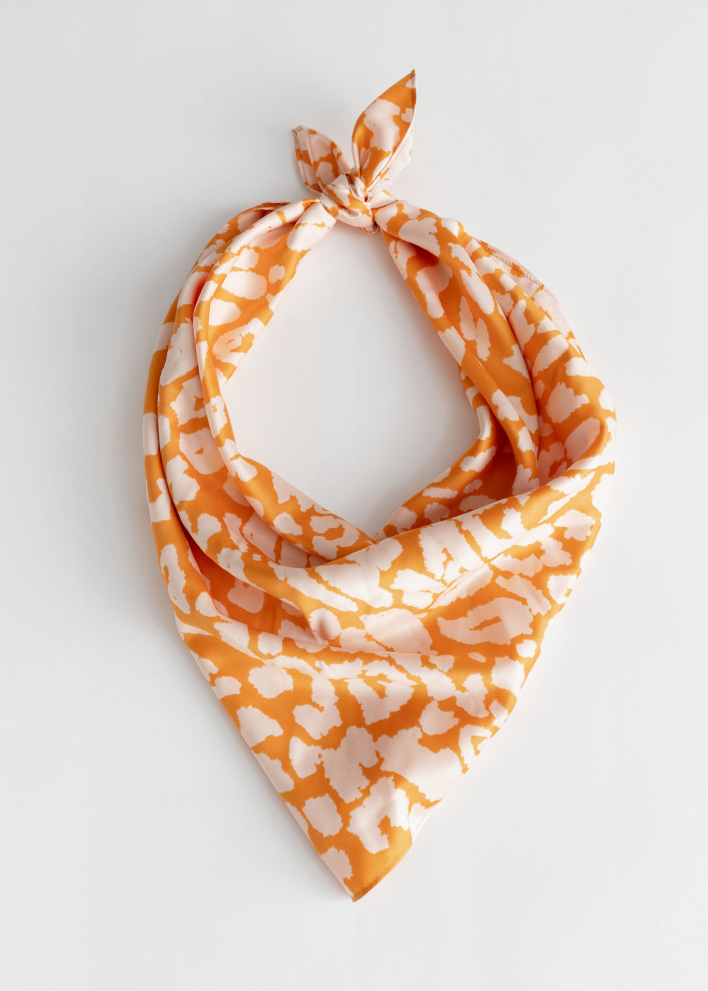 Front image of Stories leopard print satin scarf in white