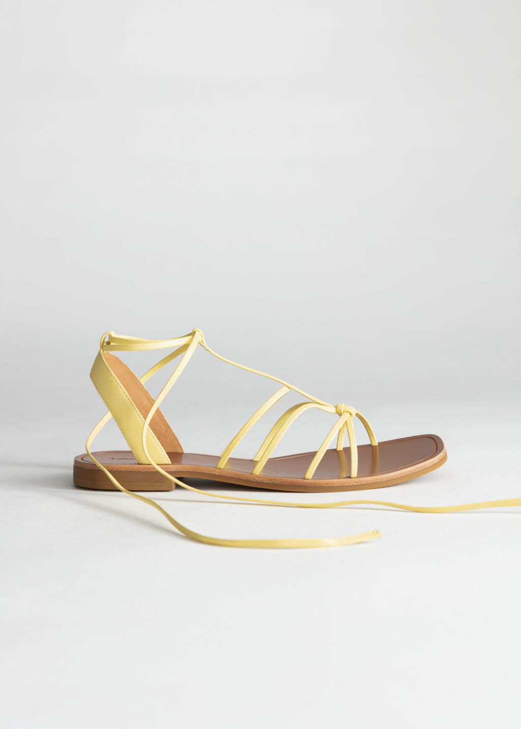 StillLife Front Image of Stories Knotted Leather Lace Up Sandals in Yellow
