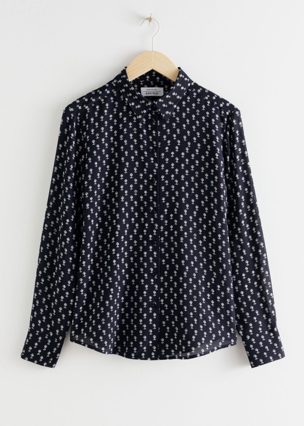 Front image of Stories leopard print silk shirt in blue