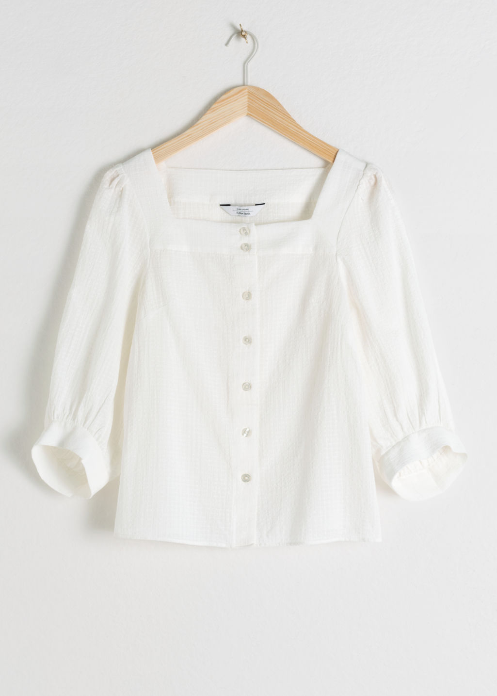 Front image of Stories plaid cotton puff sleeve blouse in white