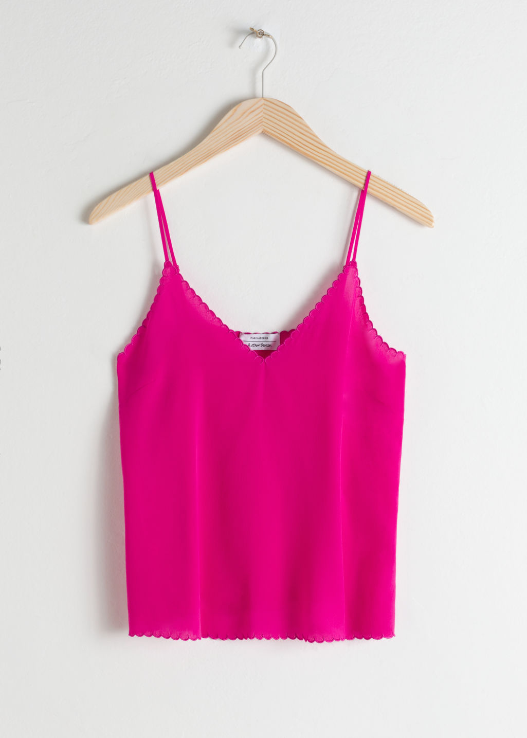 Front image of Stories scalloped silk tank top in pink