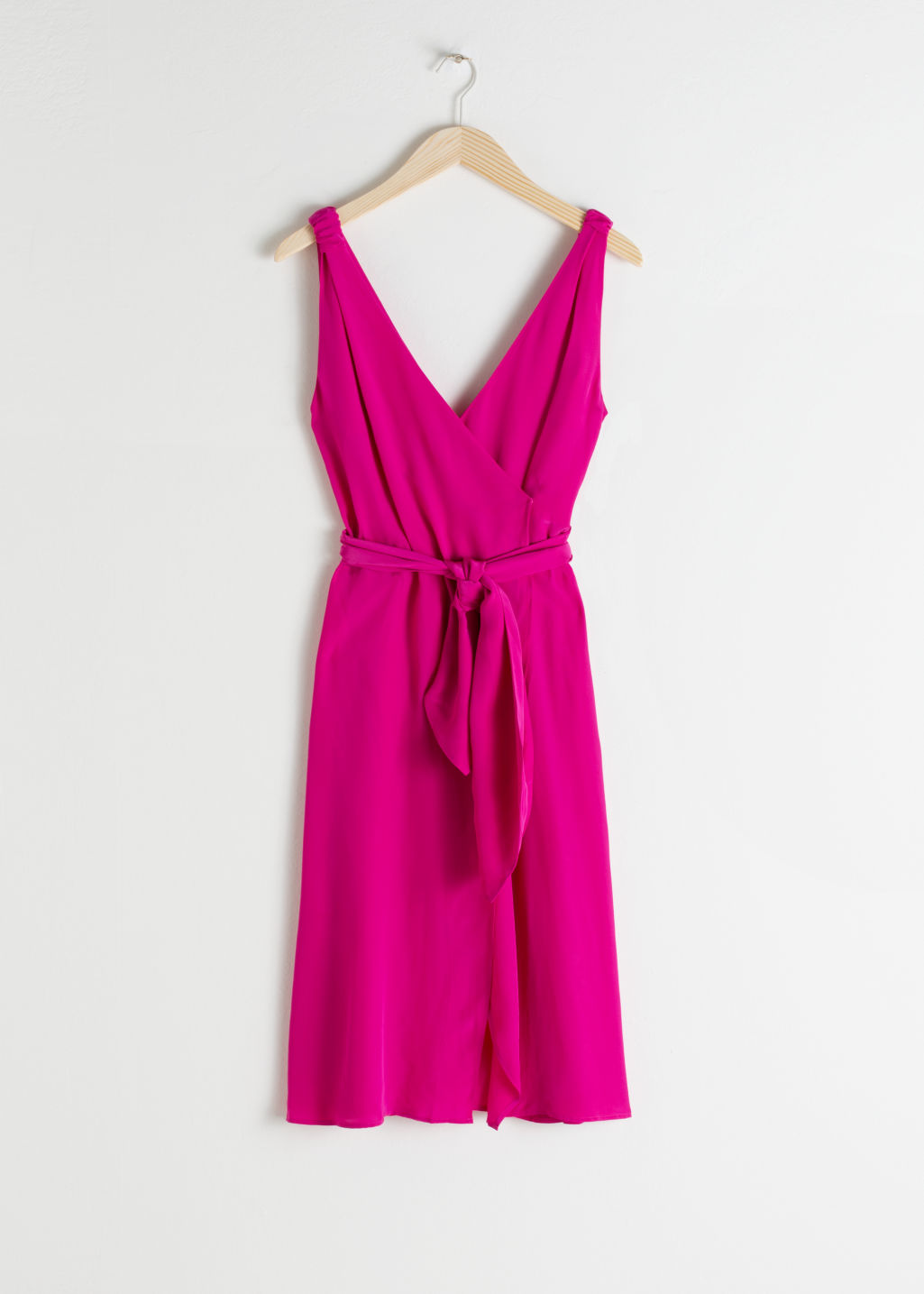 Front image of Stories sleeveless midi wrap dress in pink