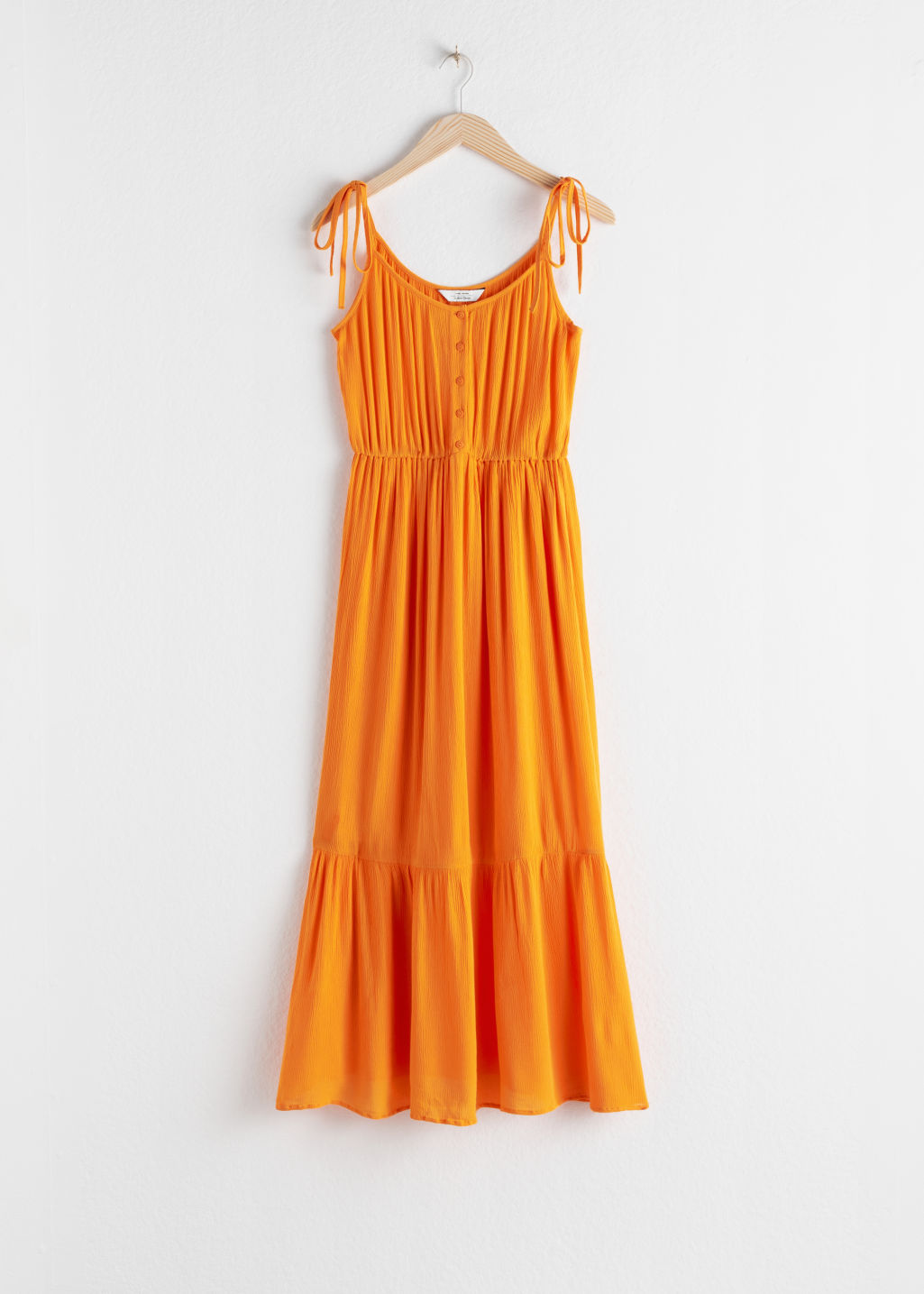 Front image of Stories ruffled tie shoulder midi dress in orange