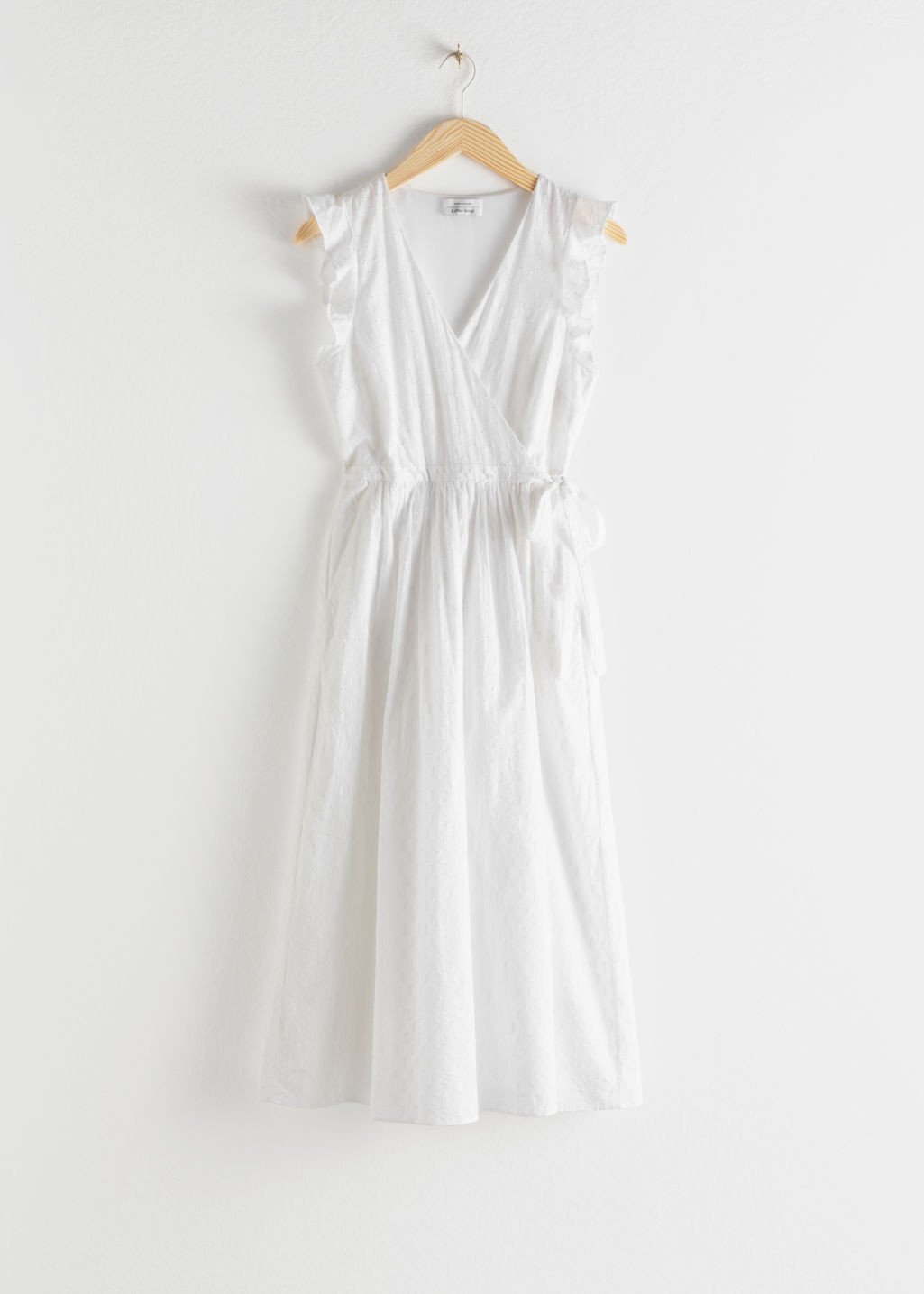 Front image of Stories ruffled cotton dobby midi dress in white