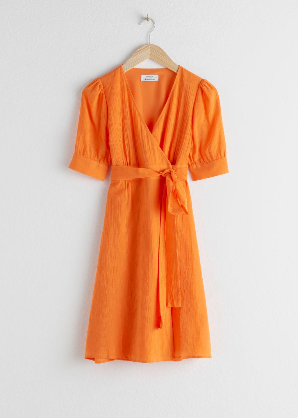 Front image of Stories cotton blend wrap mini dress in orange