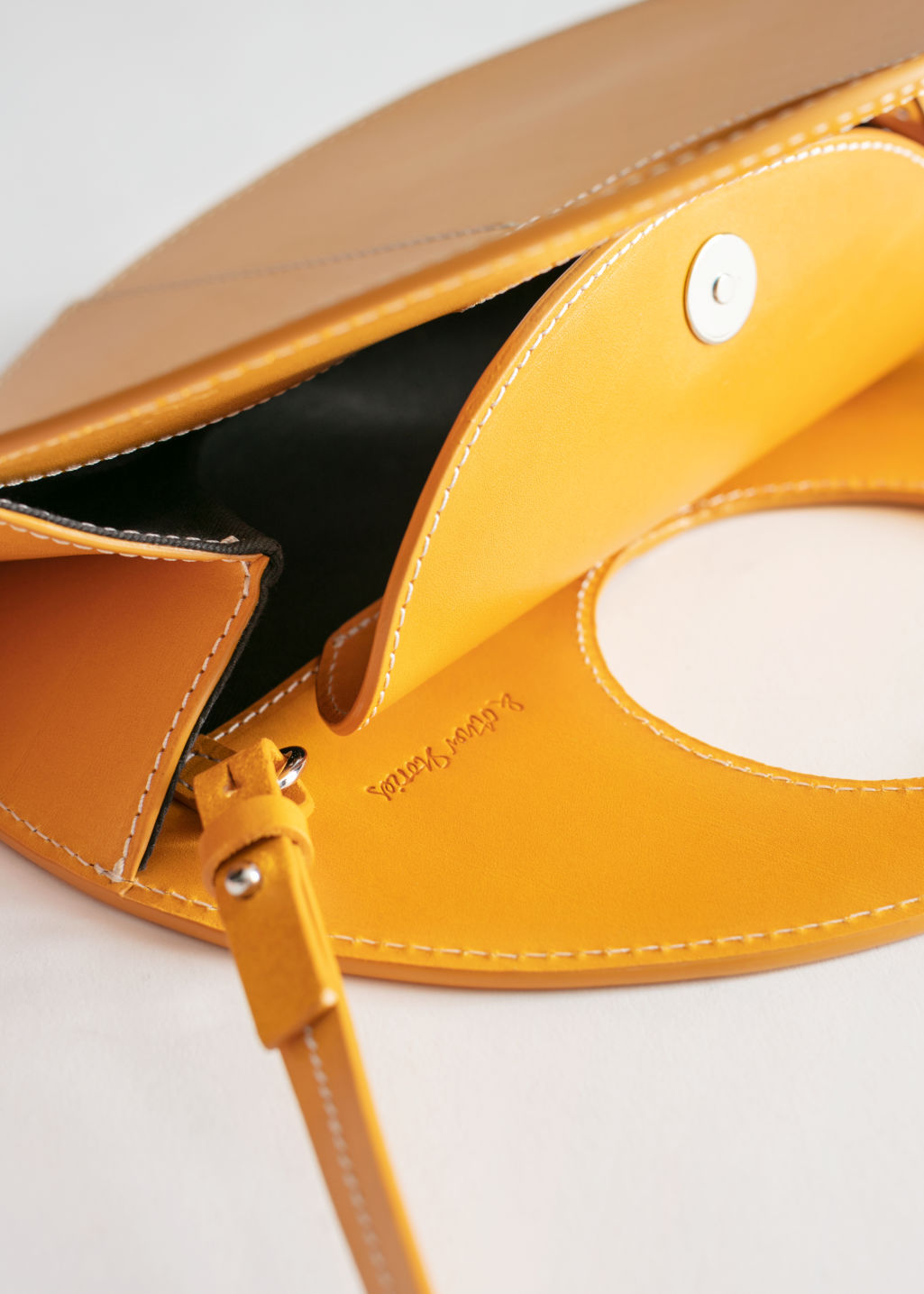 Back image of Stories structured circle crossbody bag in yellow
