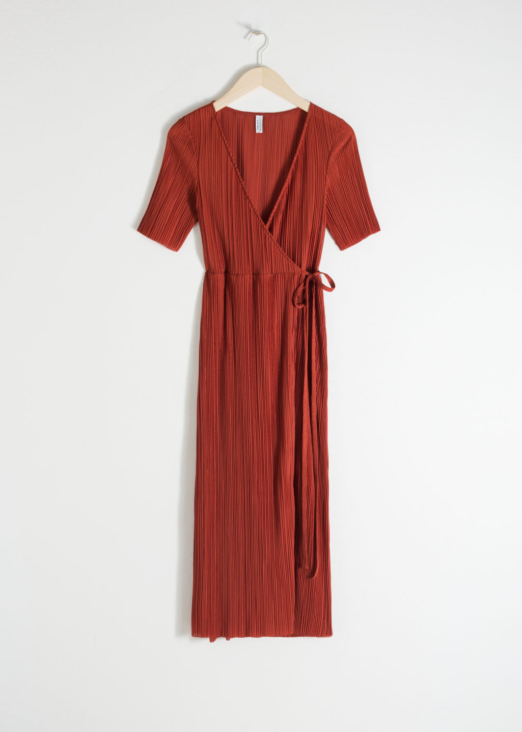 Front image of Stories plissé pleated wrap dress in orange