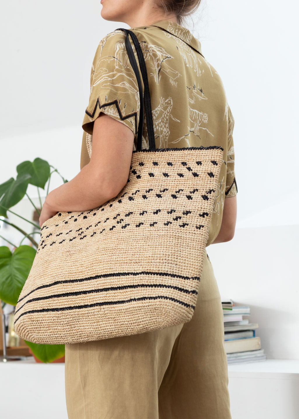 Back image of Stories graphic straw tote bag in beige