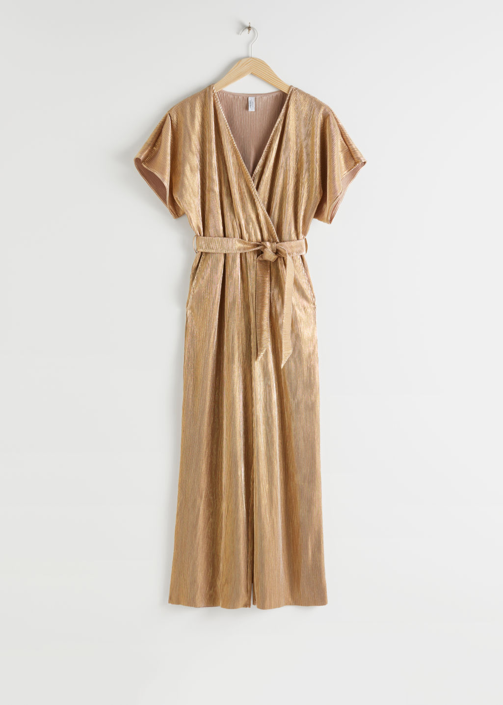 StillLife Front Image of Stories Plissé Pleated Wrap Jumpsuit in Gold
