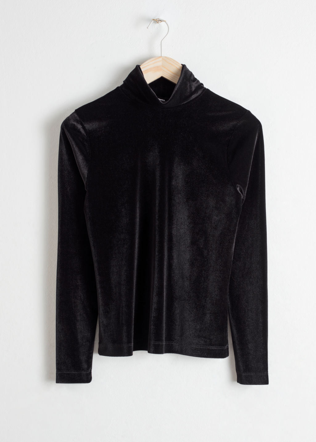 Front image of Stories fitted velvet turtleneck in black