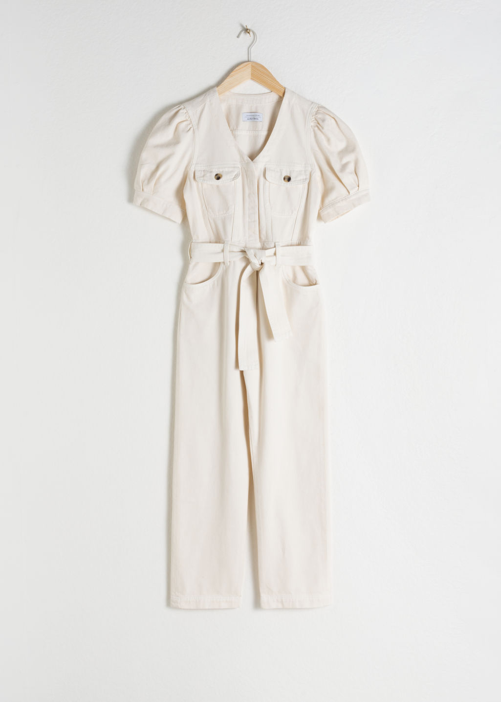 Front image of Stories belted puff sleeve denim jumpsuit in white