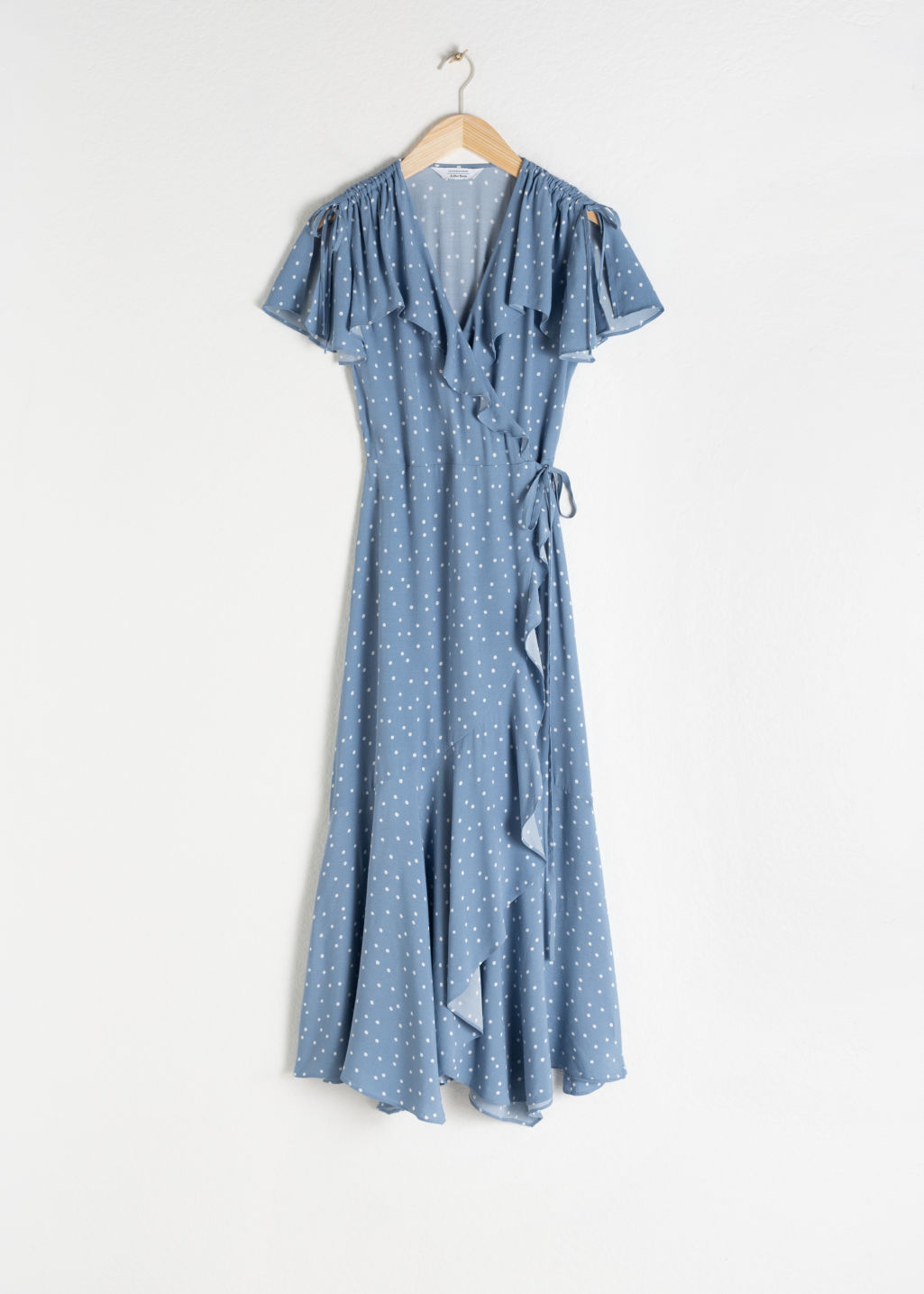 Front image of Stories ruffled handkerchief wrap midi dress in blue