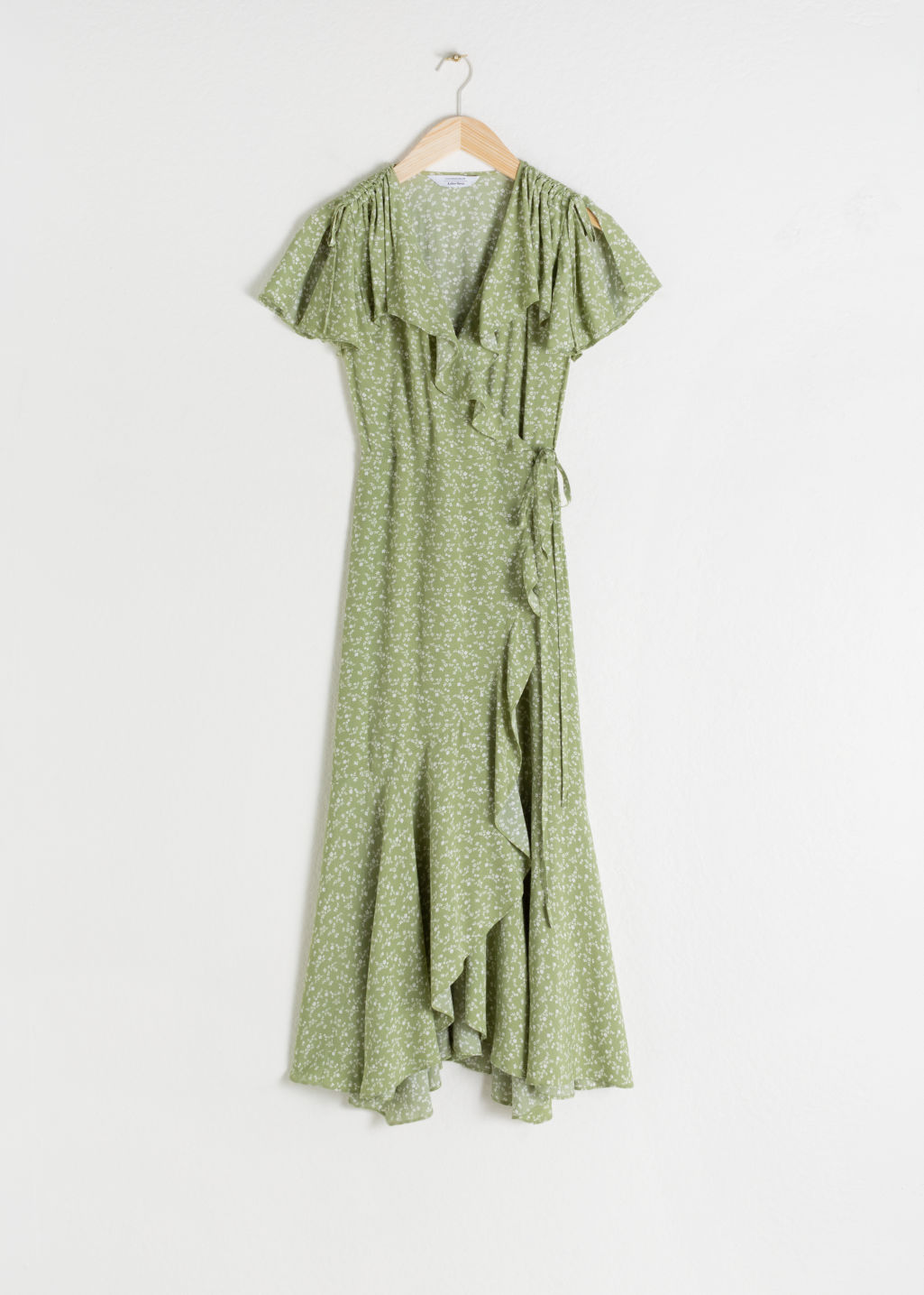 Front image of Stories ruffled handkerchief wrap midi dress in green