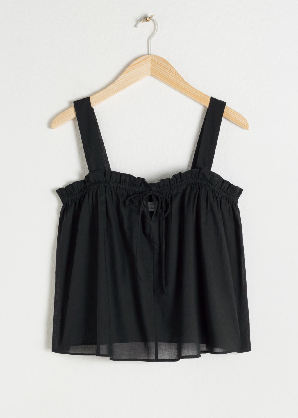 Front image of Stories drawstring ruffled cotton tank top in black