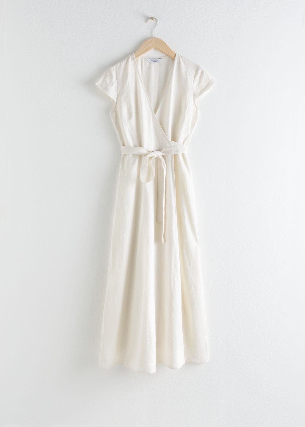 Front image of Stories linen midi wrap dress in white