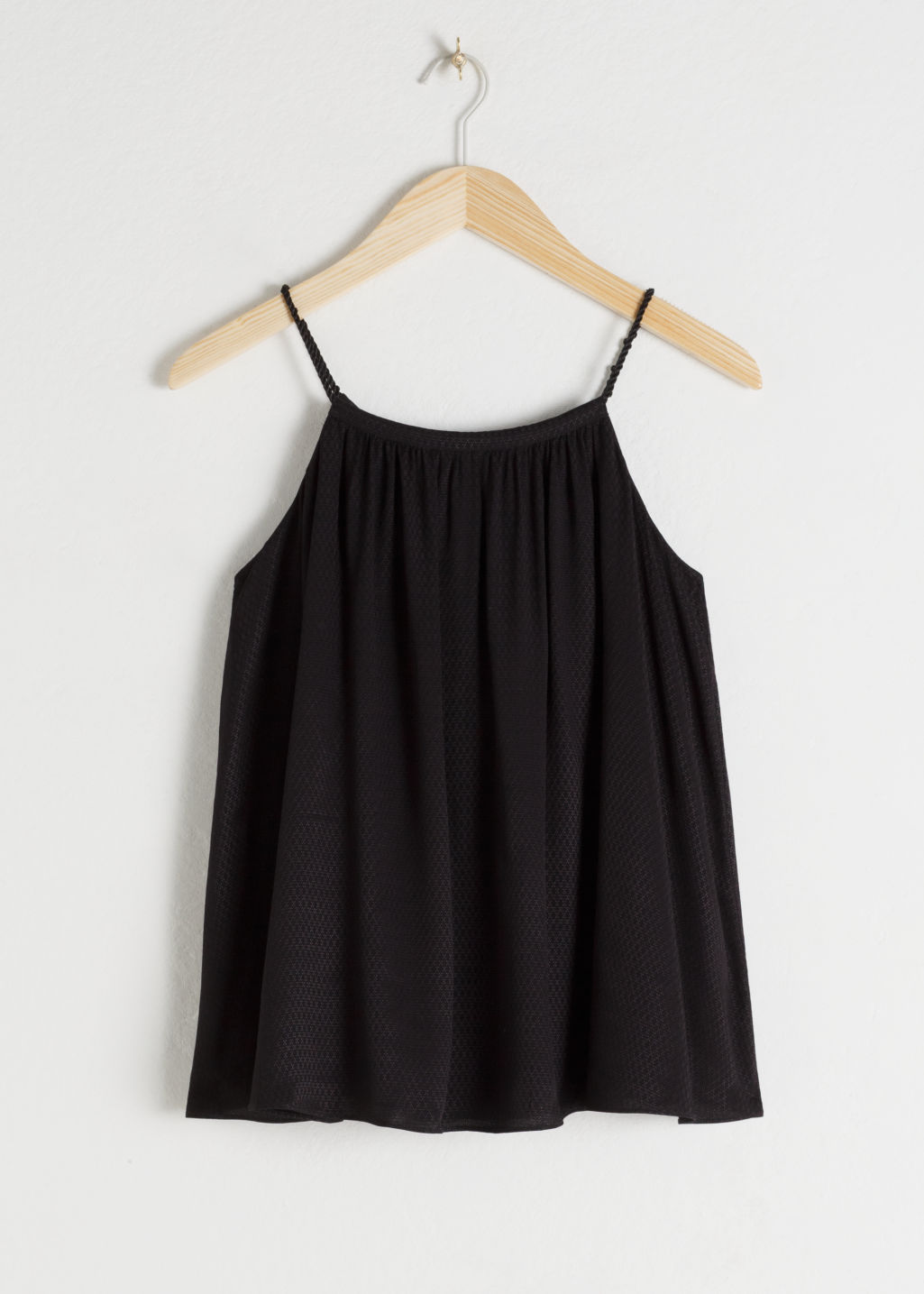 Front image of Stories a-line rope tie tank top in black
