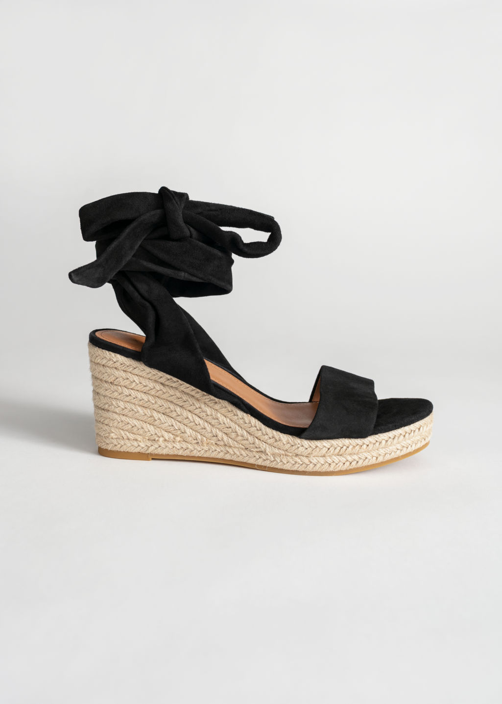 Front image of Stories suede lace up espadrille wedges in black