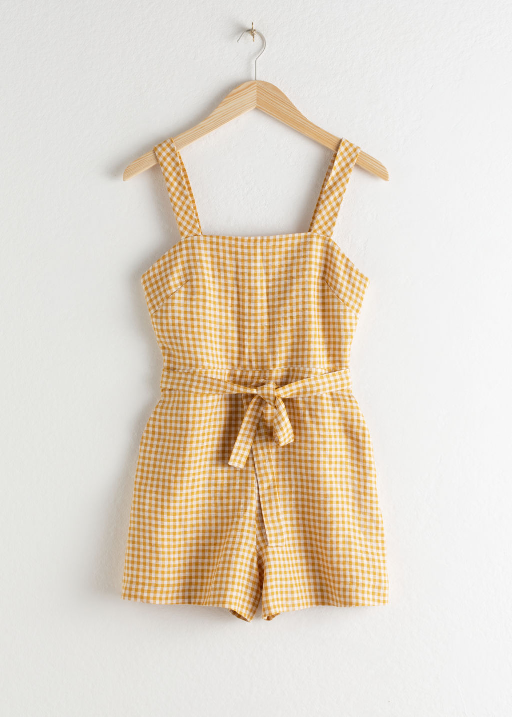 Front image of Stories square neck linen romper in yellow