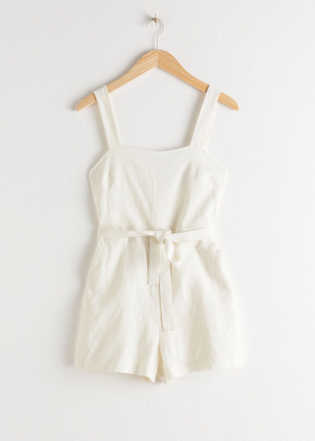 Front image of Stories square neck linen romper in white