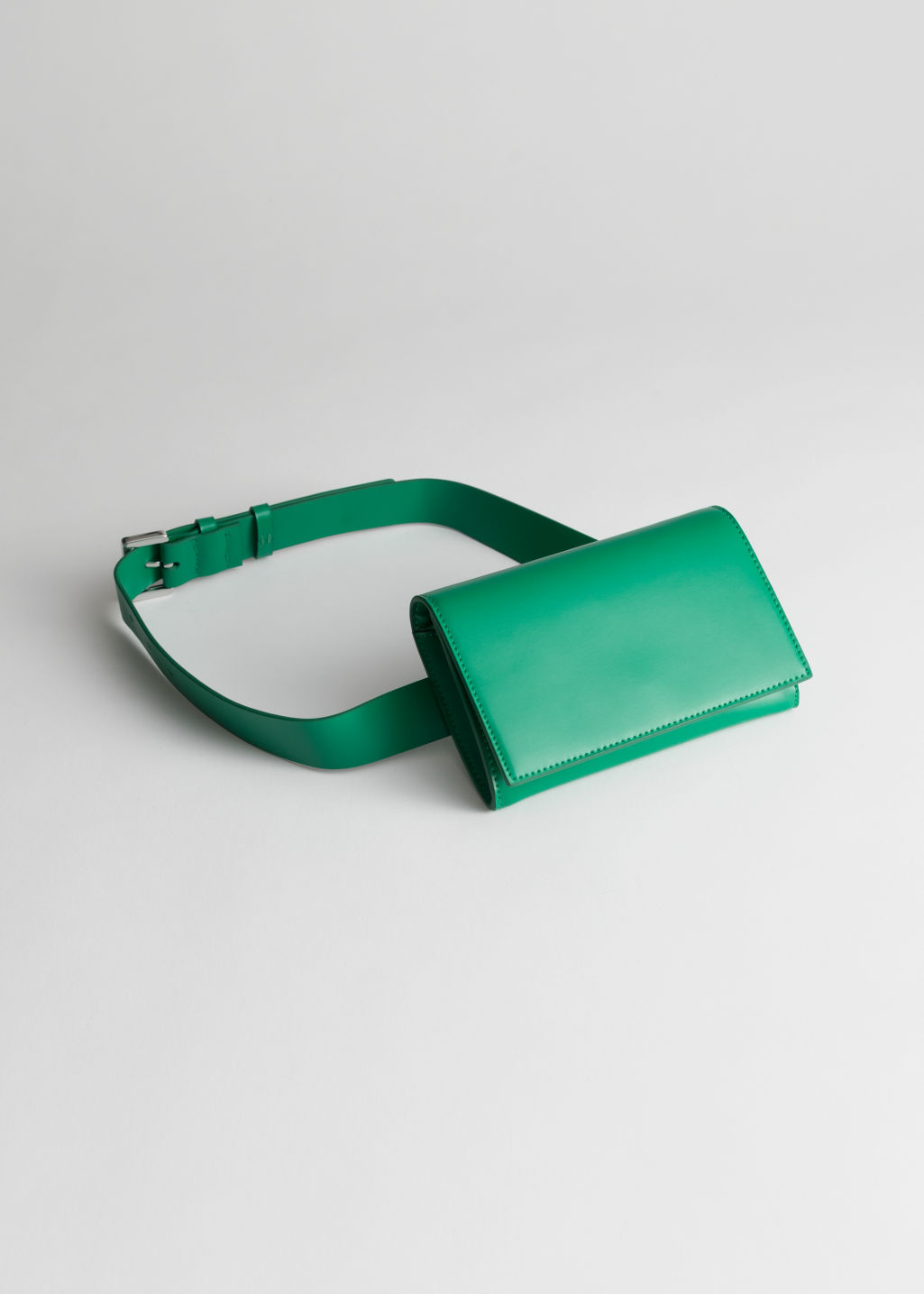 Front image of Stories leather beltbag in green