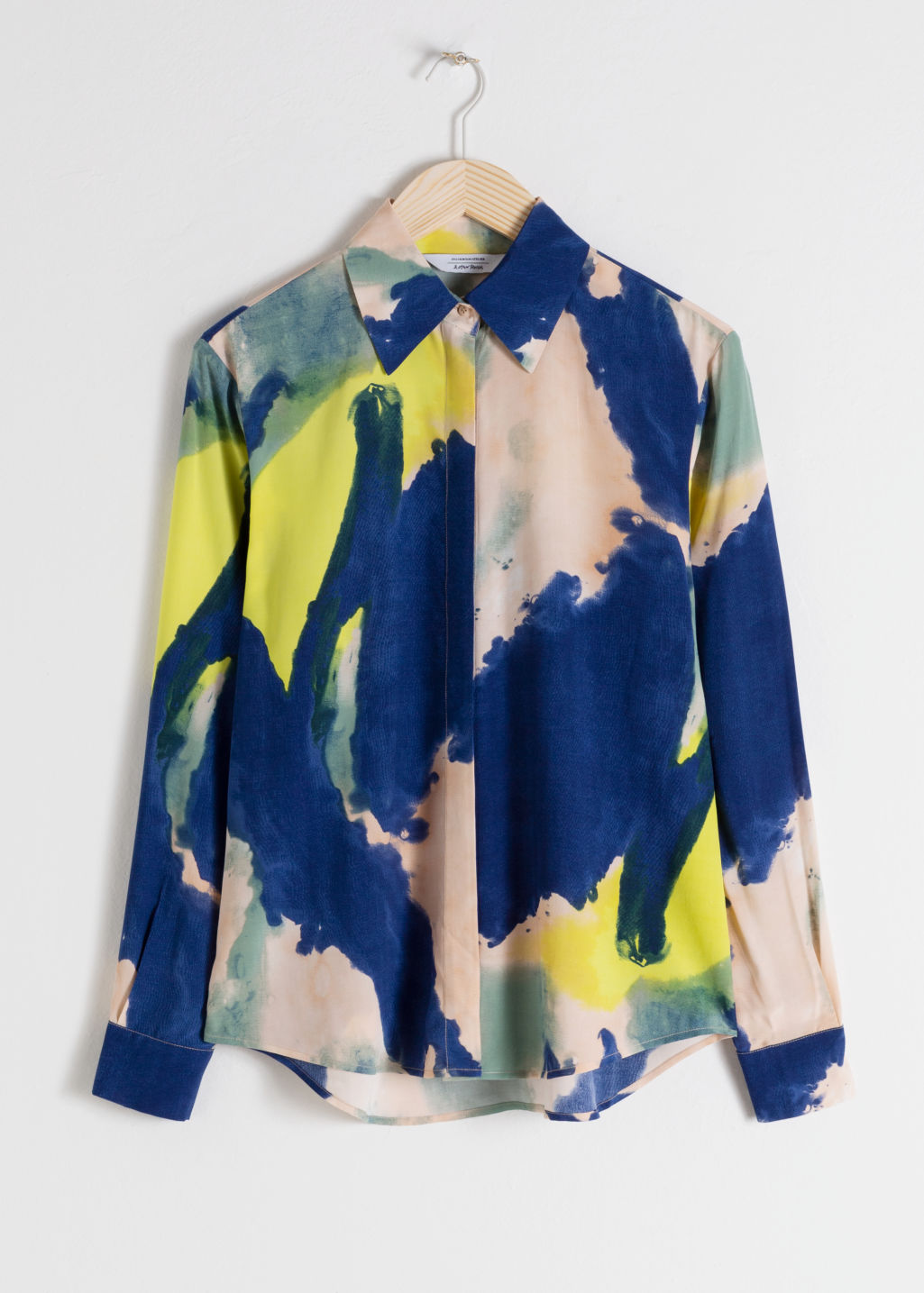 Front image of Stories watercolour button up shirt in blue