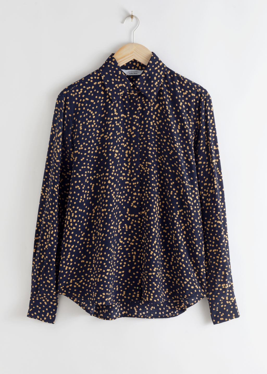 Front image of Stories printed button up shirt in black