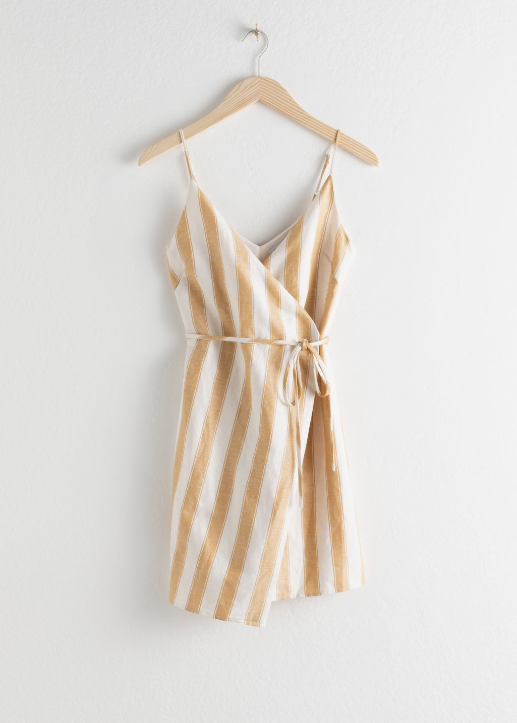 Front image of Stories striped cotton linen mini wrap dress in yellow