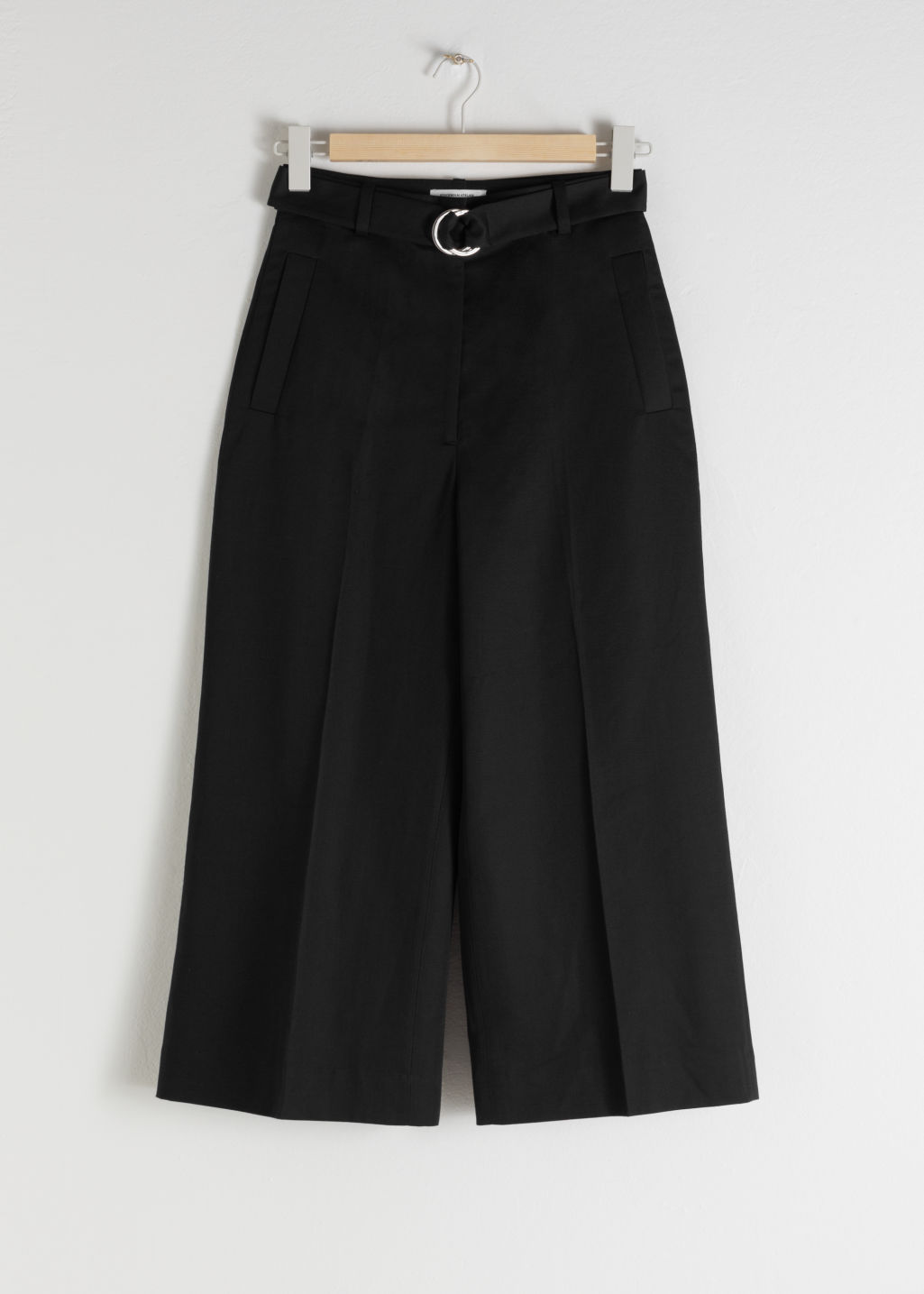 Front image of Stories cropped cotton blend belted trousers in black