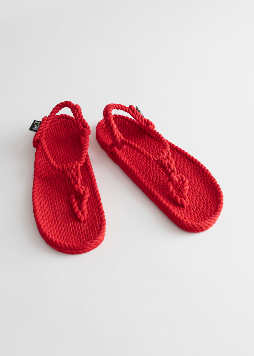 Back image of Stories nomadic state of mind sandals in red