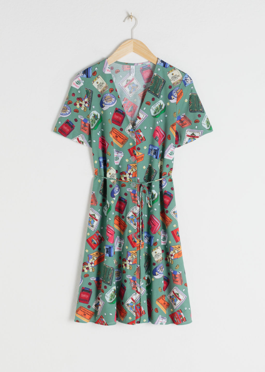 Front image of Stories belted candy print cotton dress in green