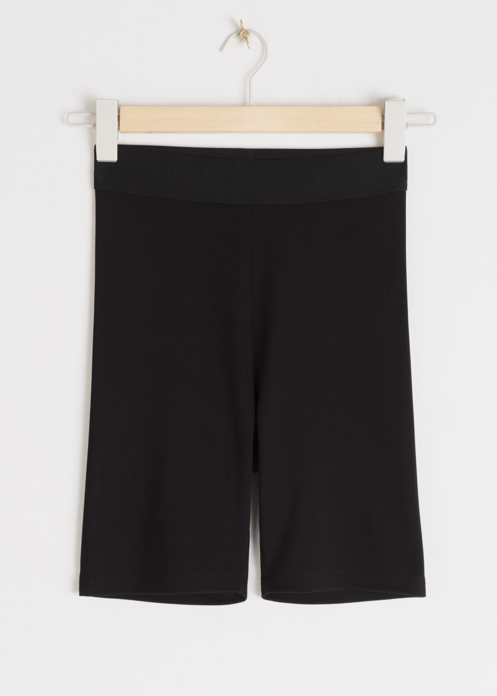 Front image of Stories high waisted cycling shorts in black