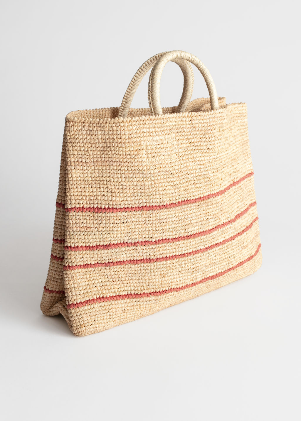 Front image of Stories large woven straw tote in beige