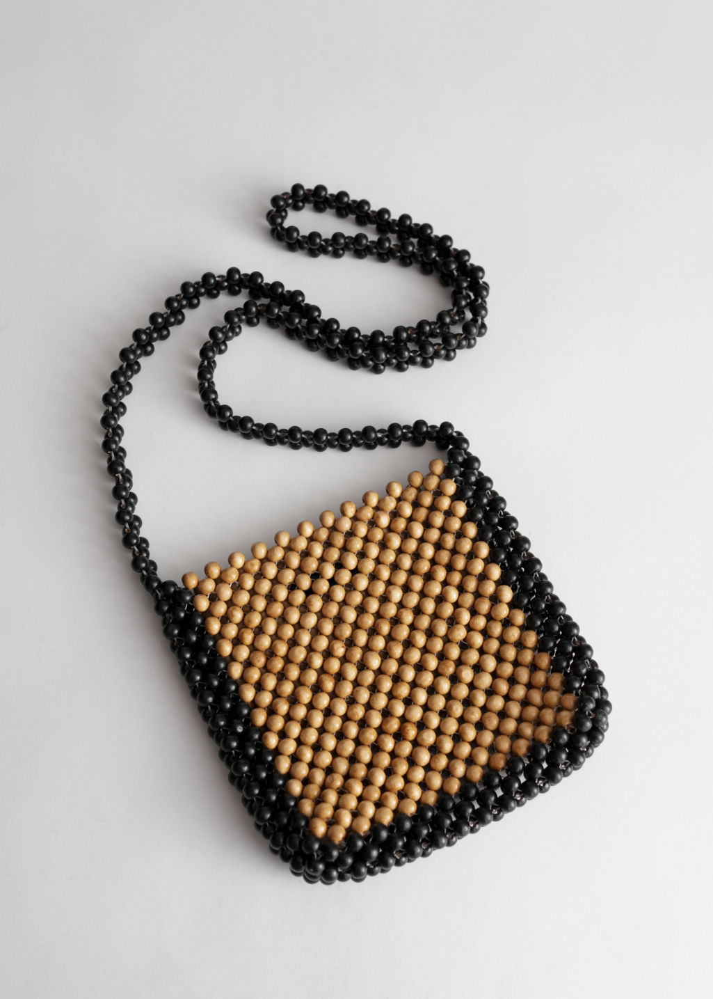 Front image of Stories beaded wood crossbody bag in brown
