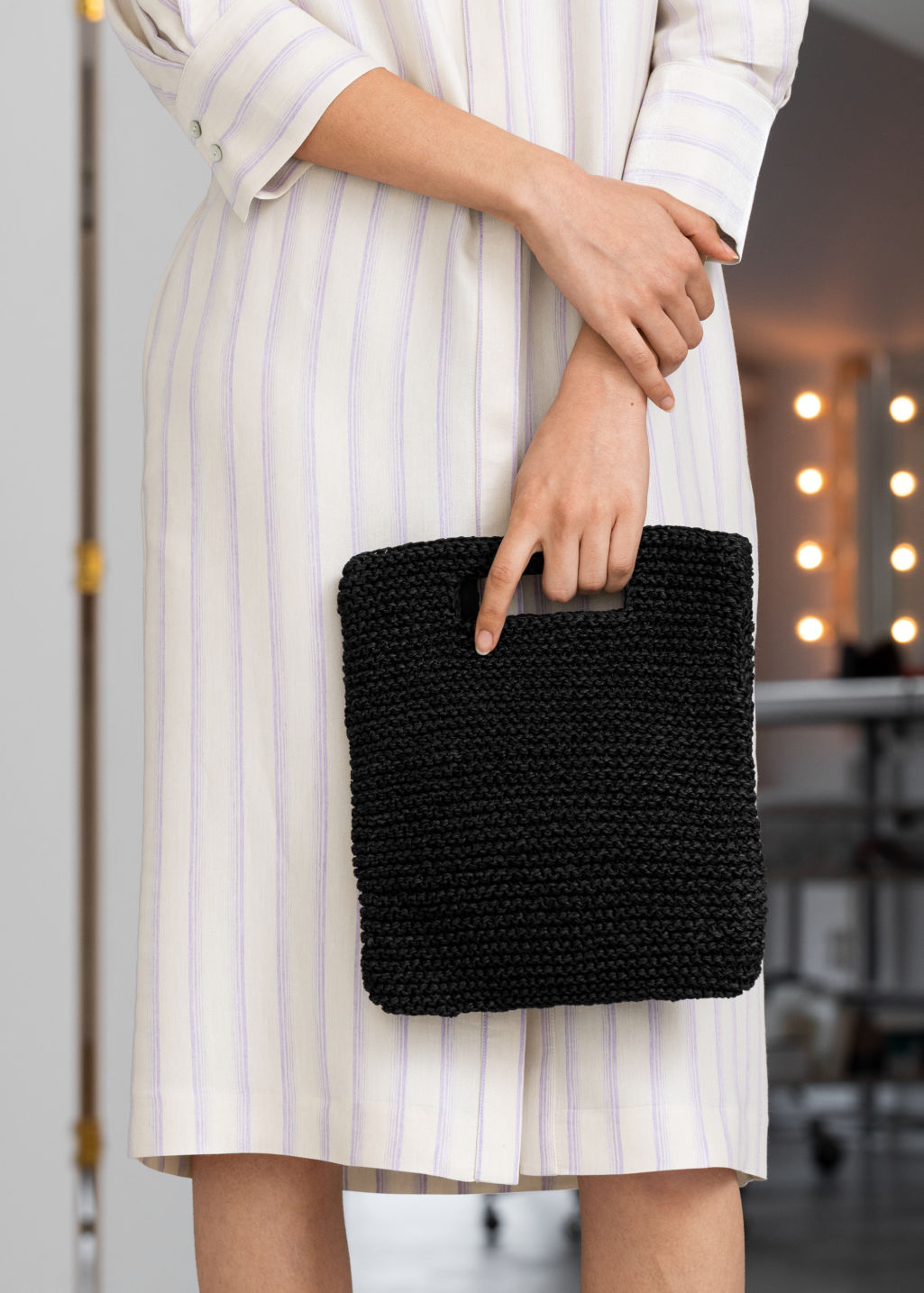 Back image of Stories woven straw clutch in black