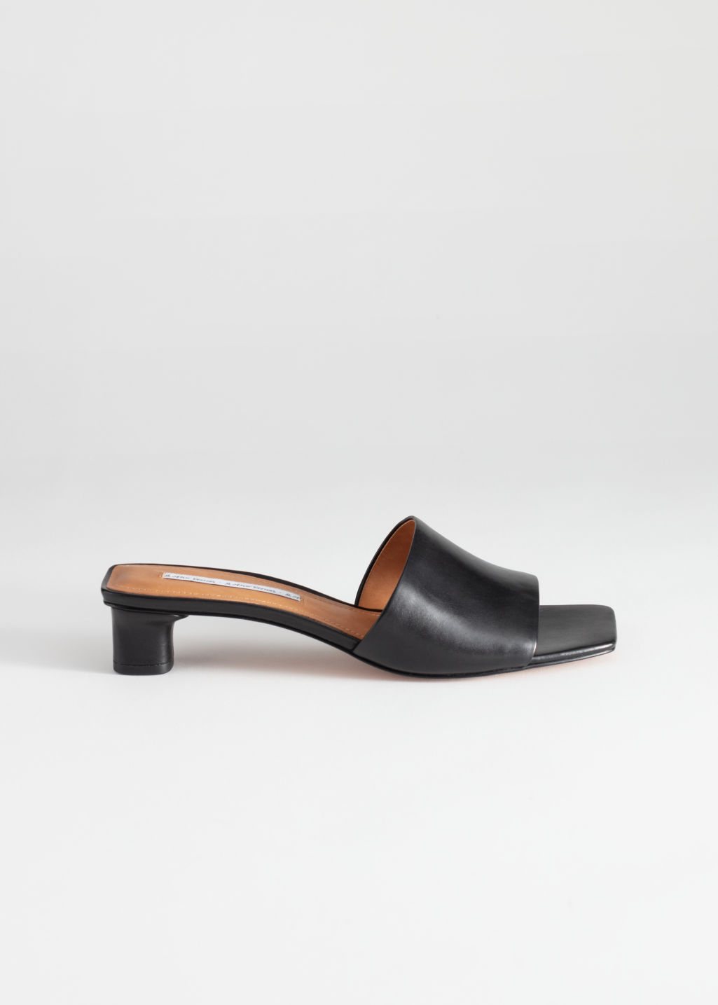 Front image of Stories square toe leather mules in black