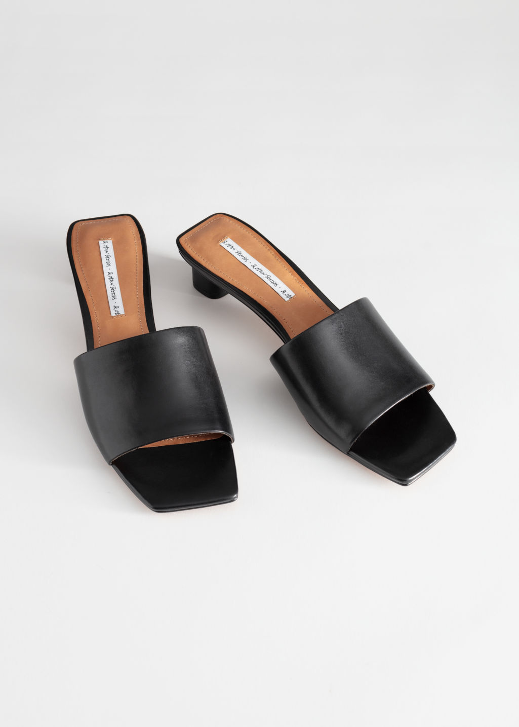 Back image of Stories square toe leather mules in black