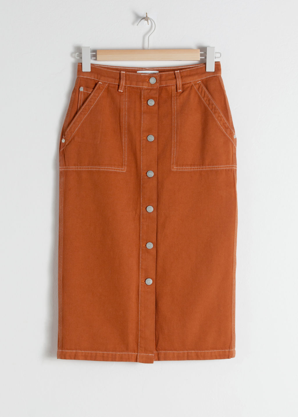 Front image of Stories mid rise denim midi skirt in orange