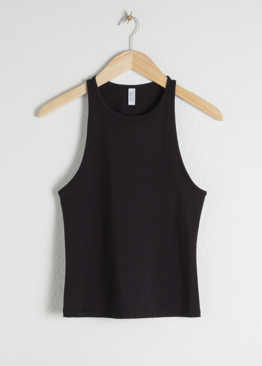 Front image of Stories cotton blend racer back tank in black