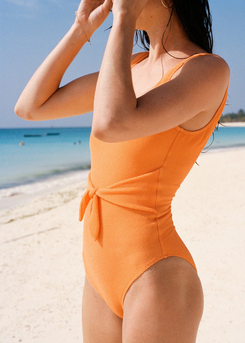 Back image of Stories waist tie swimsuit in orange
