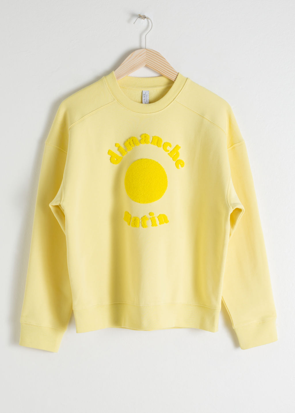 Front image of Stories dimanche matin cotton pullover in yellow