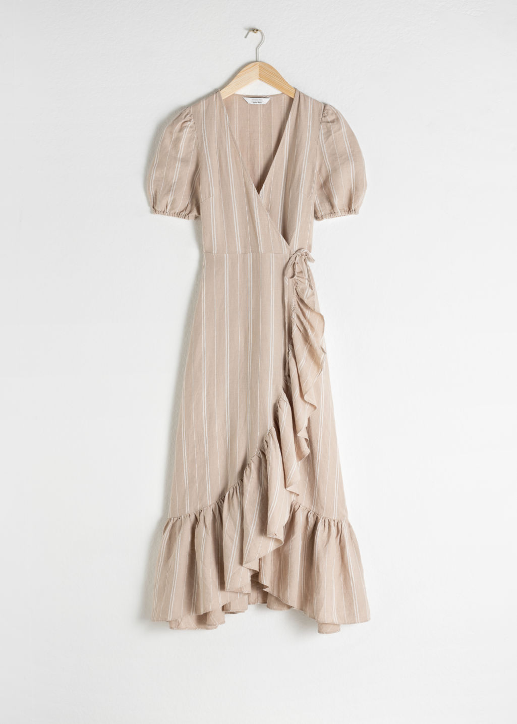 Front image of Stories ruffled linen wrap midi dress in beige