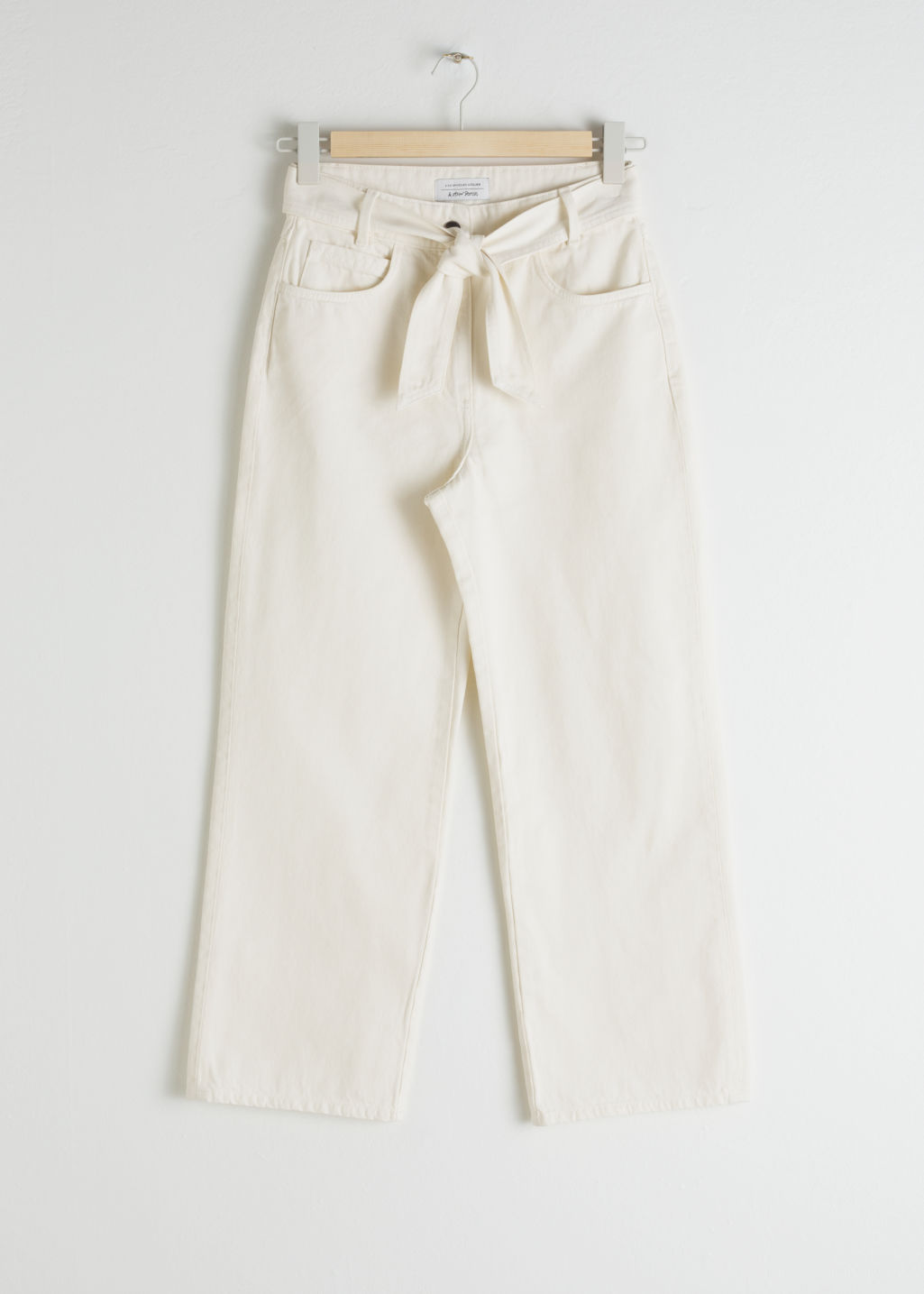 Front image of Stories cropped high rise flare jeans in white