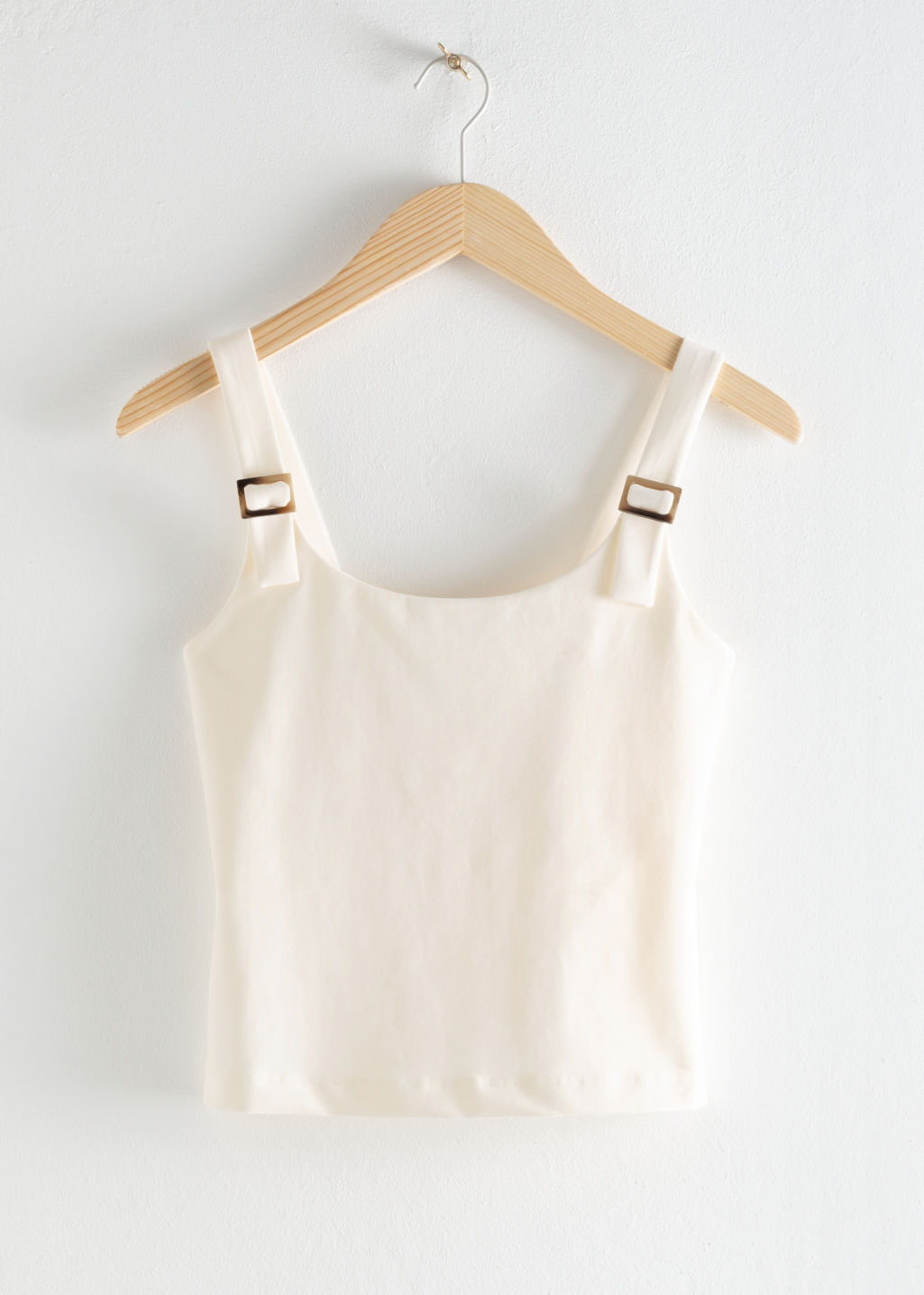 Front image of Stories square buckle strap tank top in white