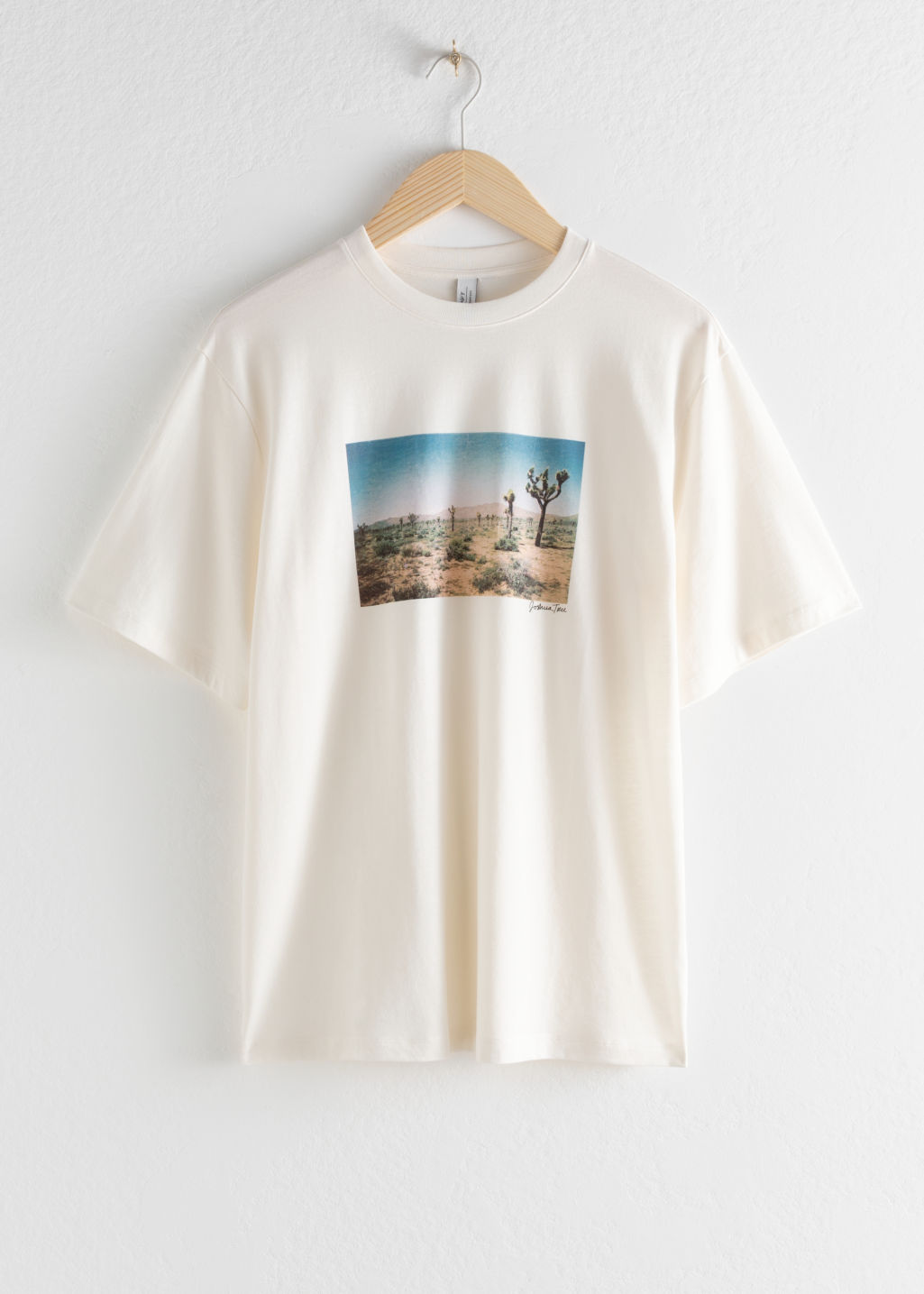 Front image of Stories desert graphic tee in white
