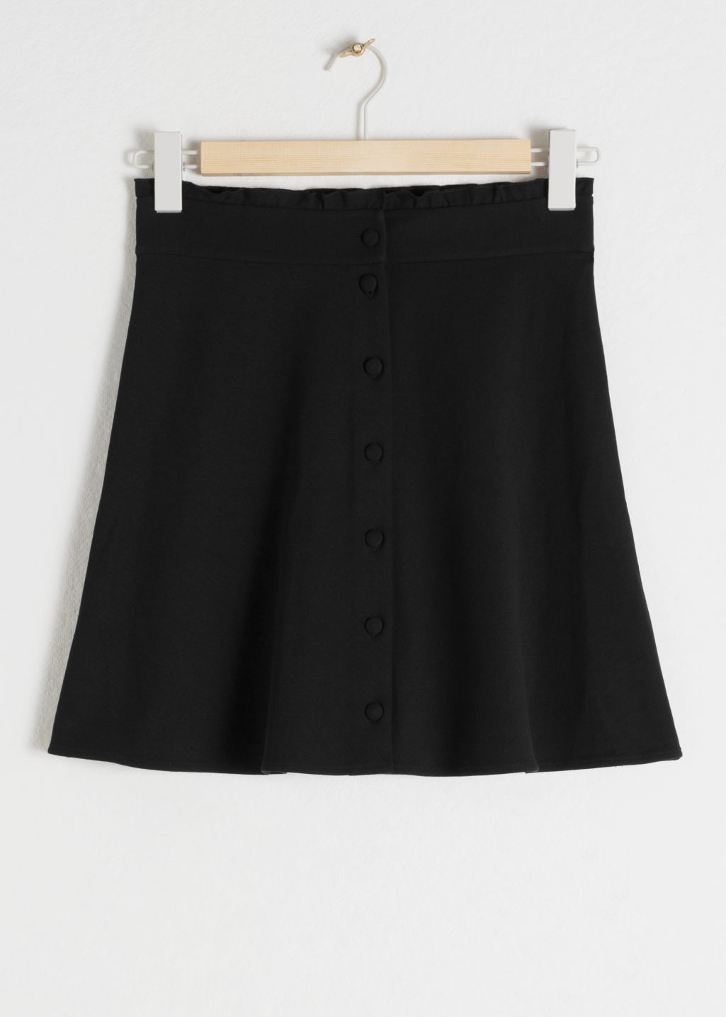 Front image of Stories ruffle waist cotton flared skirt in black