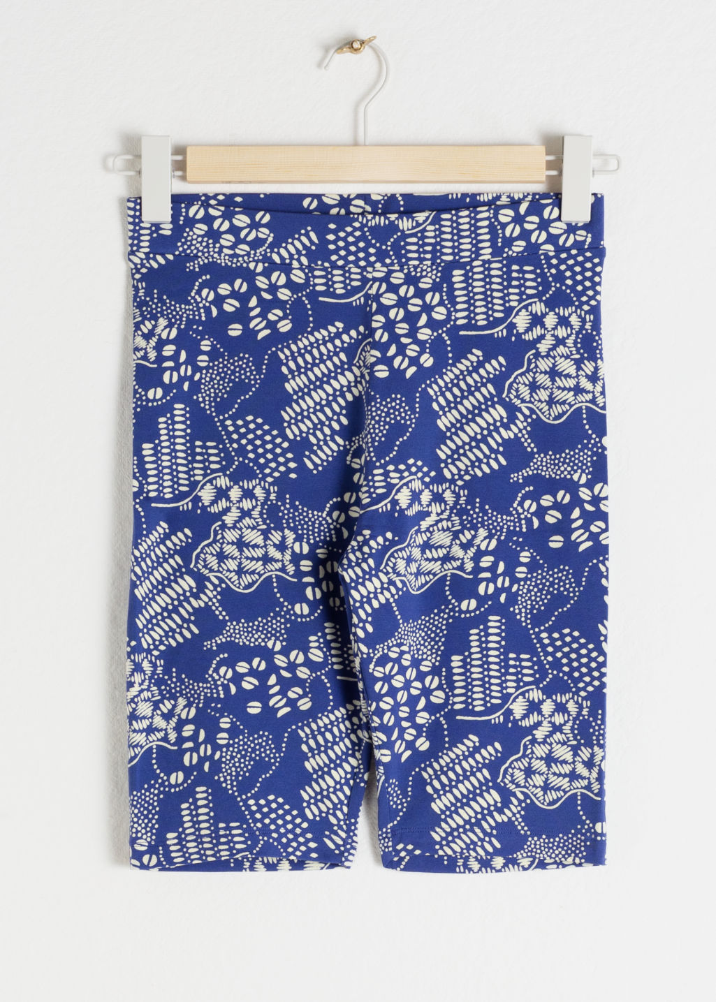 Front image of Stories coffee bean printed cycling shorts in blue