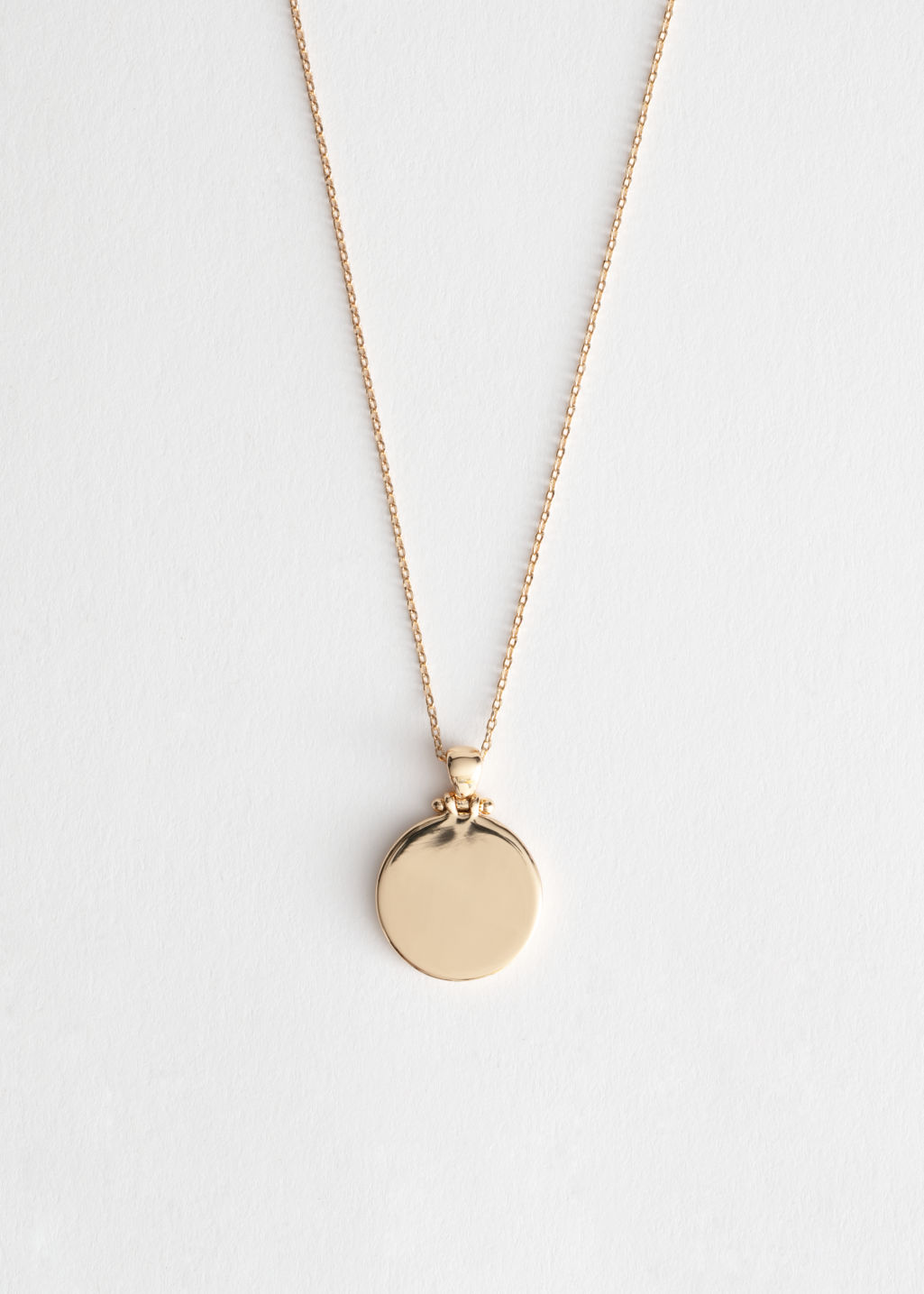 Front image of Stories circle pendant necklace in gold